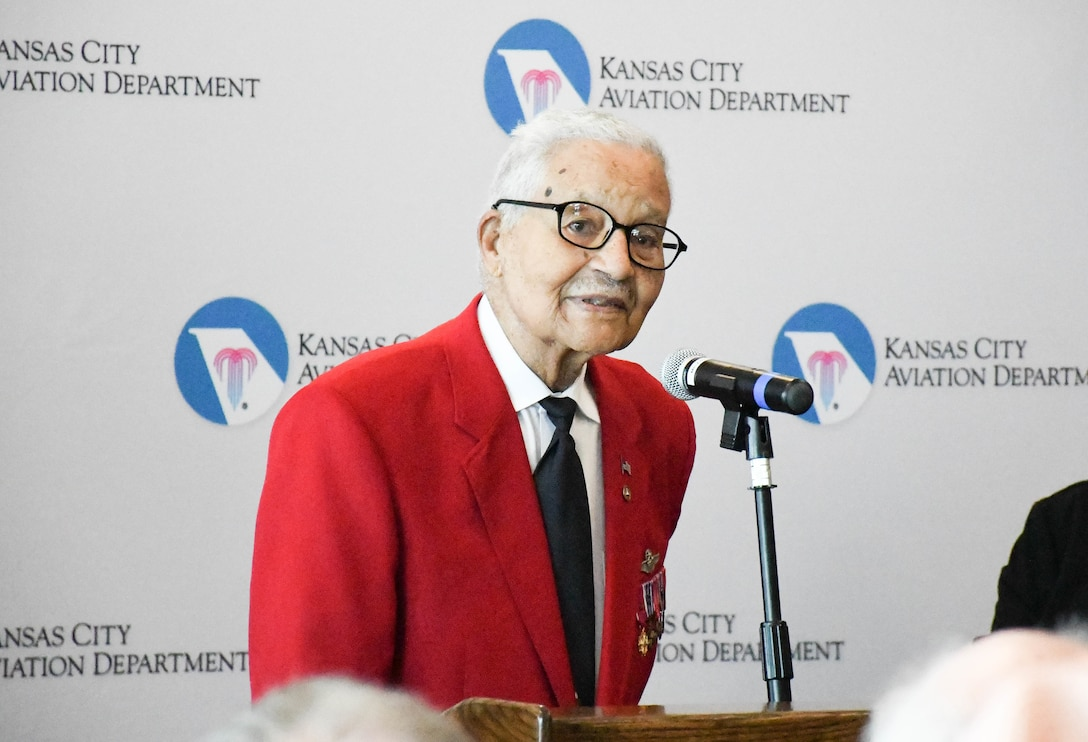 Tuskegee Airman retired Brig. Gen. Charles E. McGee speaks at the ceremony dedicating the Charles B. Wheeler Downtown Airport's general aviation terminal in his honor