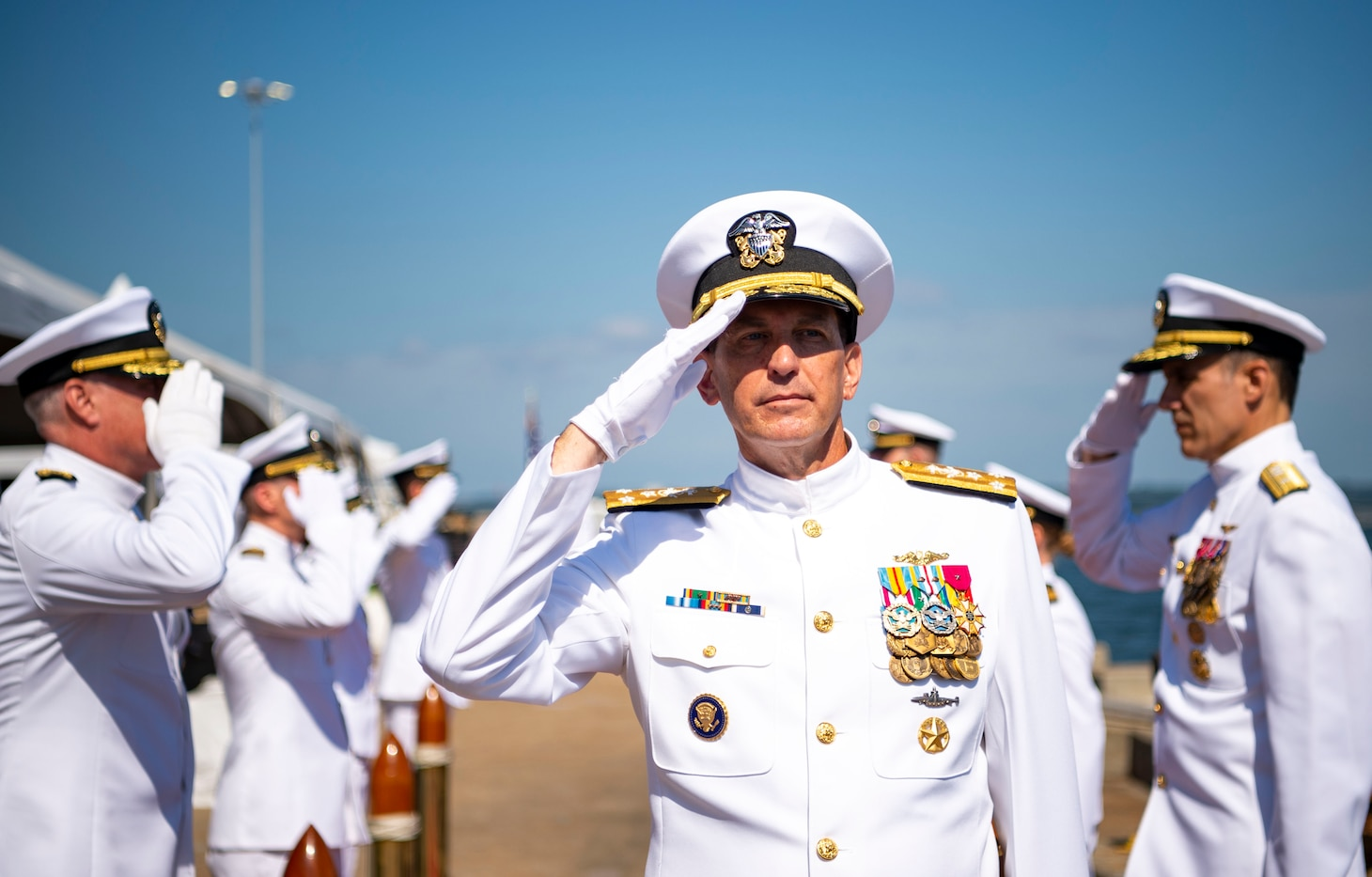 Vice Adm. David M. Kriete, center, deputy commander, U.S. Fleet Forces Command (USFFC) passes through the side boys during his retirement ceremony on board USS New Hampshire (SSN-78).