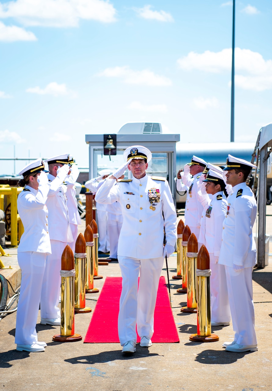 Vice Adm. David Kriete, center, deputy commander, U.S. Fleet Forces Command (USFFC) passes through the side boys during his retirement ceremony on board USS New Hampshire (SSN-78).