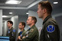U.S. Air Force pilots assigned to the 355th Fighter Squadron (FS) attend a preflight briefing on Eielson Air Force Base, Alaska, July 1, 2021.