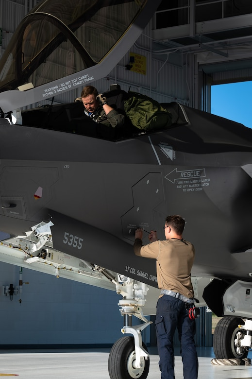 U.S. Air Force Lt. Col. Samuel Chipman, left, the 355th Fighter Squadron (FS) commander, conducts preflight inspections as an Airman assigned to the 355th Aircraft Maintenance Unit secures a panel on an F-35A Lightning II on Eielson Air Force Base, Alaska, July 1, 2021.