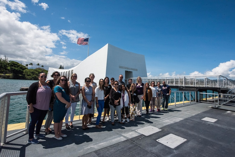 Participants of the 2021 Pacific Air Forces Squadron Commander Course pose for a photo before a barge tour of the Arizona Memorial at Pearl Harbor, Hawaii, June 24, 2021. The course enabled military spouses to discuss opportunities to solve challenges throughout the Pacific Air Forces' area of responsibility and how to overcome them with innovative ideas. (U.S. Air Force photo by Staff Sgt. Hailey Haux)