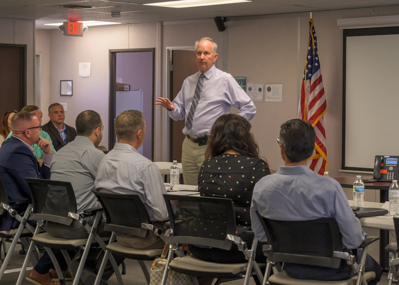 Dr. David Smith, Plant 42 director, provides opening remarks during a meeting between local civic leaders to discuss traffic safety around Plant 42 in Palmdale, California, June 30. (Air Force photo by Giancarlo Casem)