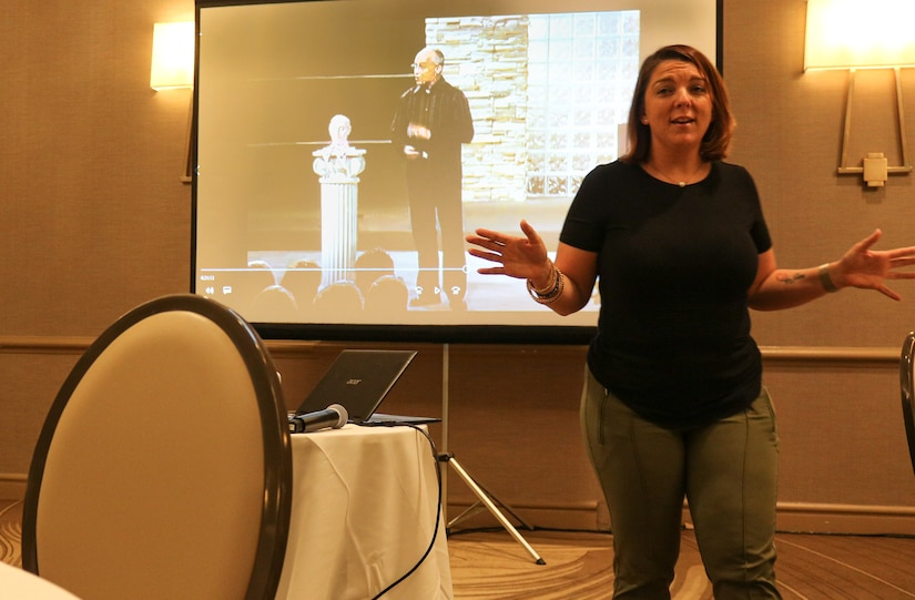 Soldier in civilian clothes speaks at conference