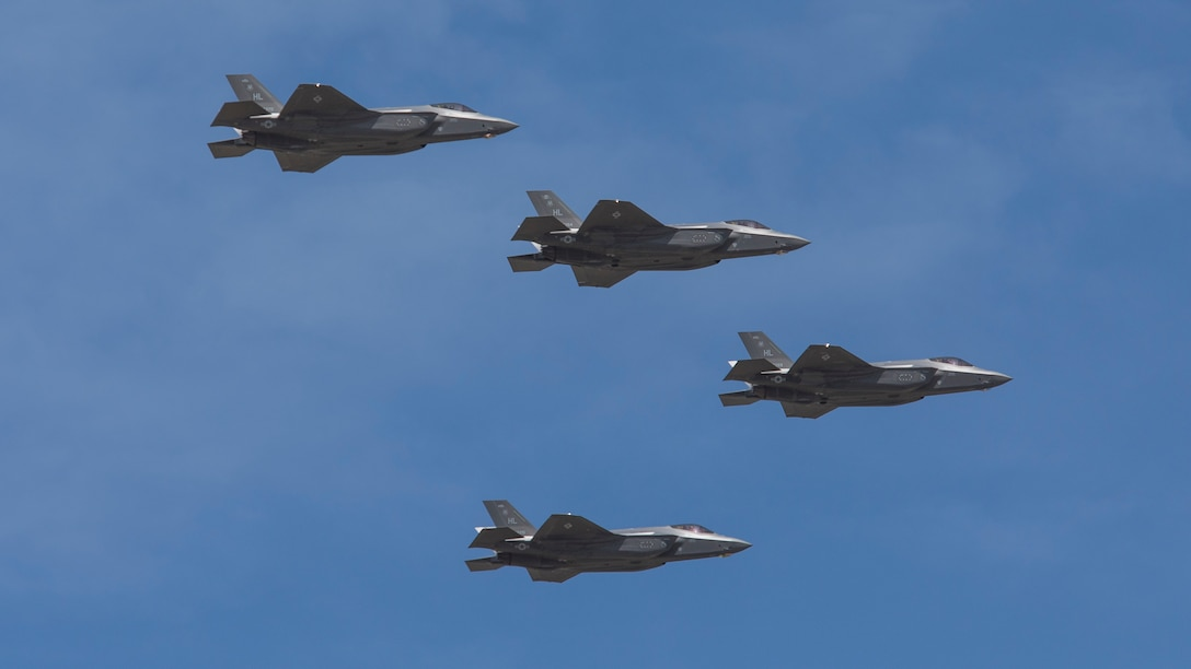 Four F-35 Lightning II jets flying in formation