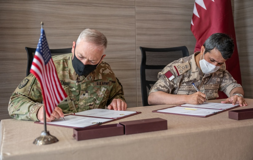 Brig. Gen. William Crane, the Adjutant General of the West Virginia National Guard, and Staff Brigadier Khalid Alkhayareen, Director of the International Forces Affairs Directory for Qatar's International Military Cooperation Authority, sign an expression of cooperation document between the State of West Virginia and the State of Qatar June 21, 2021, in Doha, Qatar. The expression of cooperation document signifies the official formalization of the partnership between West Virginia and Qatar as a part of the National Guard Bureau's State Partnership Program. (U.S. Air National Guard photo by Maj. Holli Nelson)