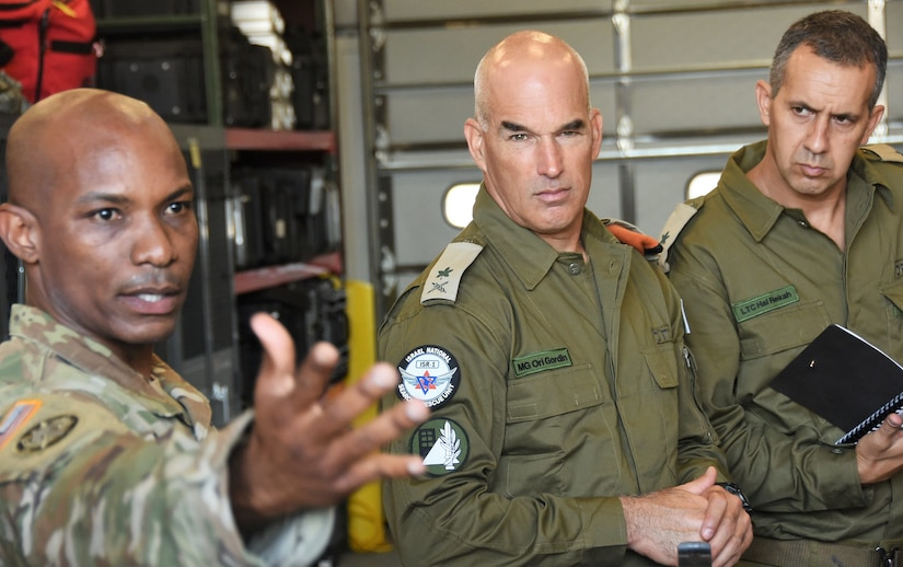 New York Army National Guard Maj. Del Gustave, assigned to the 24th Civil Support Team, briefs Israeli Maj. Gen. Ori Gordin, commander of the Israeli Defense Force Home Front Command, center, and Lt. Col. Hal Rekah, the Home Front Command liaison officer for the National Guard Bureau, during a capability brief of the CST for Home Front Command at Fort Hamilton, Brooklyn, N.Y. on June 28, 2021.
