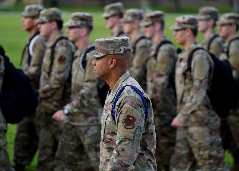 """U.S. Air Force Tech. Sgt. Alvin Morris, 336th Training Squadron master military training leader, marches Airmen in training to school on Keesler Air Force Base, Mississippi, June 29, 2021. """"I've been empowered with the tools to mold Airmen to be successful and to also challenge them to grow,"""" said Morris. """"Understanding this pivotal role and short amount of time that I have to impact each Airman keeps me ready to mentor, train and lead at all times.Developing our Airmen, watching them grow into leaders is very fulfilling for my position."""" (U.S. Air Force photo by Senior Airman Spencer Tobler)"""