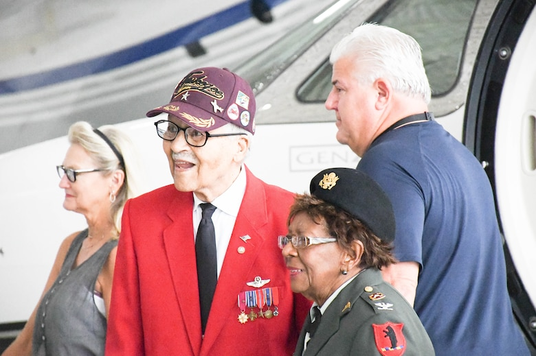 Tuskegee Airman retired Brig. Gen. Charles E. McGee and retired U.S. Army Col. Cloe Degraffenreid deplane at the Atlantic terminal at Charles B. Wheeler Downtown Airport.