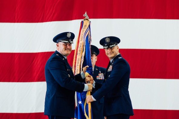 Col. Chris Robinson, right, 375th Air Mobility Wing commander, assumes command of the 375th AMW after receiving the Wing's guidon from Maj. Gen. Thad Bibb, Jr., 18th Air Force commander, on Scott Air Force Base, Illinois, July 1, 2021. The change of command ceremony represents a time-honored military tradition providing an opportunity for Airmen to witness the transfer of power to their newly appointed commanding officer. (U.S. Air Force photo by Tech. Sgt. Jordan Castelan)