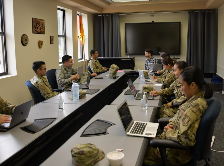 Cadets, participants of  the Puerto Rico Project Language program, engage with their instructor at Maxwell Air Force Base, Alabama, June 25, 2021. The four week program hosted a total 45 cadets, providing them with necessary skills to pass the Air Force Officer's Qualification Test, such as, verbal skills and confidence needed to communicate during live training events. (U.S. Air Force photo by Senior Airman Rhonda Smith)