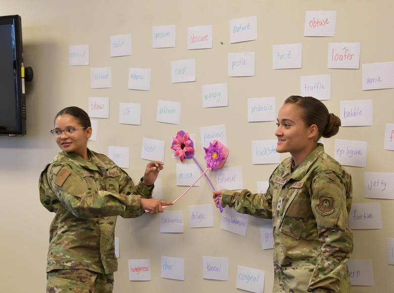 Cadet Patria Navedo and Cadet Alanis Delgado, Puerto Rico Project Language participants, play a grammar and vocabulary game during class at Maxwell Air Force Base, Alabama, June 25, 2021. The fly swat word game is a word comprehension game that gives the cadets practice and familiarity with words that would potentially be on the Air Force Officer's Qualification Test. (U.S. Air Force photo by Senior Airman Rhonda Smith)