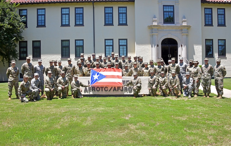 Cadets, participants of  the Puerto Rico Project Language program, pose for a group photo at Maxwell Air Force Base, Alabama, June 17, 2021. The PRPL is a four week program that was derived from the Defense Language Institute English Language Center program that provided U.S. Army trainees, who were permanent residents or U.S. citizens, with English-language training and cultural immersion. (U.S. Air Force photo by Senior Airman Rhonda Smith)