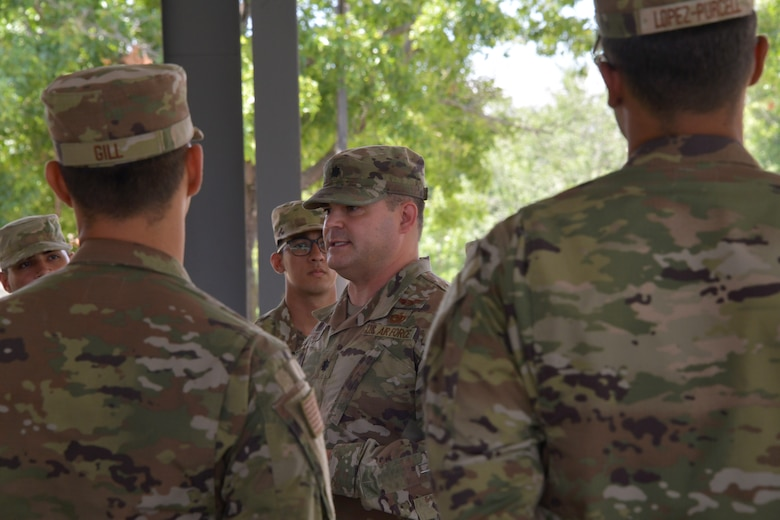 Lt. Col. Justin Settles, Deputy Director for the China Aerospace Studies Institute, gives a speech to cadets during the Puerto Rico Project Language program at Maxwell Air Force Base, Alabama, June 25, 2021.The four week program hosted a total 45 cadets, providing them with necessary skills to pass the Air Force Officer's Qualification Test, such as, verbal skills and confidence needed to communicate during live training events. (U.S. Air Force photo by Senior Airman Rhonda Smith)
