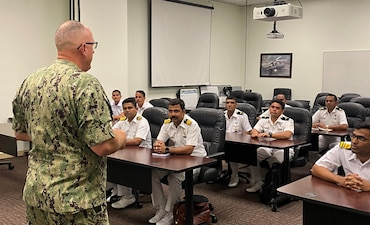 SAN DIEGO -- (July 2, 2021) Cmdr. Kent Davis, Center for Naval Aviation Technical Training Unit North Island commanding officer, speaks to a group of Indian Navy Sailors. (U.S. Navy photo)
