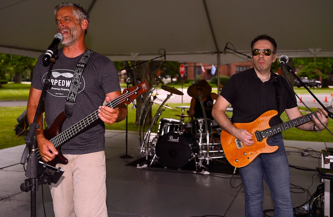 Dave Garwood (left) provides lead vocals and bass while David Hurley plays guitar for Velvet Crush during the first Block Party Concert at Turtle Pond in the brick quarters historic district June, 24, 2021, at Wright-Patterson Air Force Base, Ohio. Other block parties scheduled by the 88th FSS are set to include performances by Stranger, a band specializing in the hits of the 1980s, and Parrots of the Caribbean, which is a salute to Jimmy Buffett. (U.S. Air Force photo by R.J. Oriez)