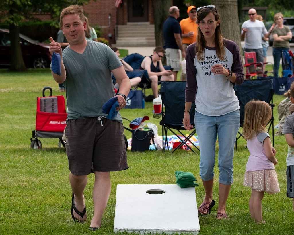Maj. Jacob Collie, and his wife Tanya, play cornhole at a block party sponsored by the 88th Force Support Squadron June 24, 2021, at the Turtle Pond in the brick quarters historic district at Wright-Patterson Air Force Base, Ohio. The event featured music, games, food and sponsor booths and gave the Wright-Patt community an opportunity to get out and socialize. (U.S. Air Force photo by R.J. Oriez)
