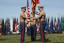 U.S. Marine Corps Maj. Daniel Chamberlin, left, oncoming commanding officer, Recruiting Station (RS) Frederick, Sgt. Maj. Michael Collins, senior enlisted advisor, RS Frederick, center, and Maj. Evan Fairfield, outgoing commanding officer of RS Frederick, right, preform the passing of the colors during the RS Frederick change of command ceremony on June 25, 2021. The ceremony represents the passing of leadership from Fairfield to Chamberlin. (U.S. Marine Corps photo by Sgt. Ryan Sammet)