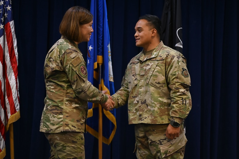 Chief Master Sgt. of the Air Force JoAnne S. Bass coins Tech. Sgt. Darwincarl Mendoza, 61st Medical Squadron bio environmental engineer, after an enlisted all call July 1, 2021, at Los Angeles Air Force Base, California. Bass thanked Space and Missile Systems Center and 61st Air base Group enlisted members for their dedication to the U.S. Air and Space Force and their perspective and honest feedback on service-wide initiatives. (U.S. Space Force photo by Staff Sgt. Andrew Moore)