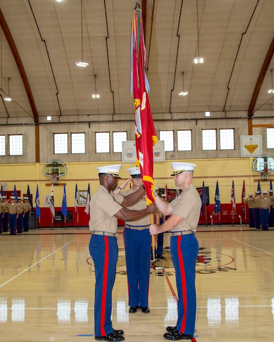 Colonel Gregory B. Pace receives the colors as he assumes command from Col. Craig C. Clemans, during the Change of Command ceremony held aboard Marine Corps Logistics Base Barstow, California, July 1. Colonel Pace comes to Barstow from his latest role as the G4 with 2d Marine Expeditionary Brigade, II Marine Expeditionary Force.