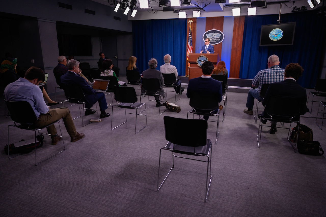 A man speaks to the press.
