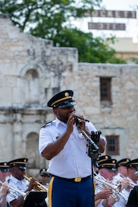 """Staff Sgt. Randy Holmes, assigned to """"Fort Sam's Own"""" 323d Army Band, sings """"Armed Forces Salute,"""" during an Independence Day concert held at The Alamo, July 2, 2021. The 323rd performed with the 313th Army Band, a U.S. Army Reserve band from Redstone Arsenal in Huntsville, Alabama. (U.S. Army Photo by Bethany Huff)"""