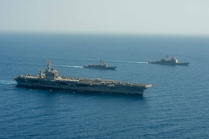 Aircraft carrier USS Dwight D. Eisenhower (CVN 69), left, Egyptian Navy guided-missile frigate ENS Taba (FFG 916), center, and guided-missile cruiser USS Vella Gulf (CG 72) conduct a passing exercise in the Red Sea, June 29. The Eisenhower Carrier Strike Group is deployed to the U.S. 5th Fleet area of operations in support of naval operations to ensure maritime stability and security in the Central Region, connecting the Mediterranean and Pacific through the western Indian Ocean and three strategic choke points.