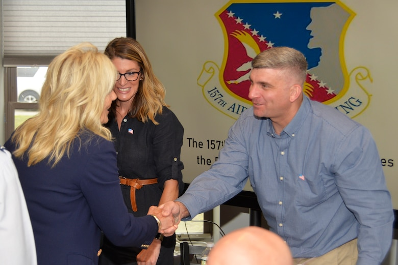 First Lady Dr. Jill Biden, left, shakes hands with U.S. Army Staff Sgt. Scott Auditore, New Hampshire Army National Guard 197th Field Artillery Brigade, while his wife, Danyelle looks on, Pease Air National Guard Base, July 3.