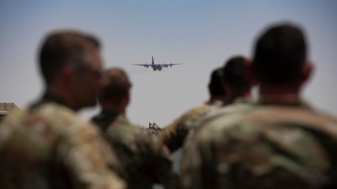 """A U.S. Air Force C-130H Hercules, approaches for landing during a """"fini flight"""" over Ali Al Salem Air Base, Kuwait, July 4, 2021."""