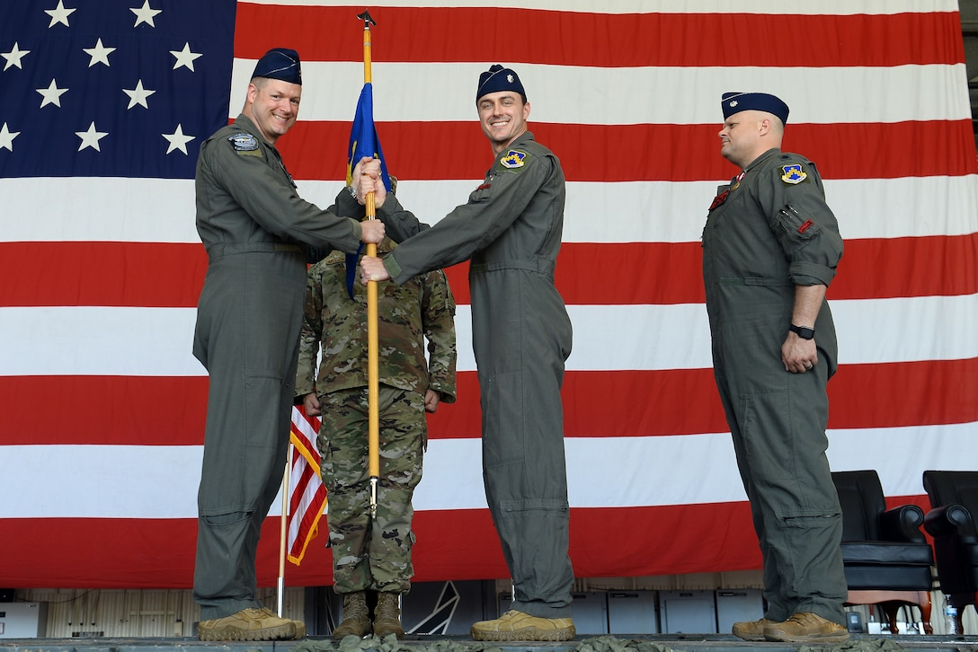 Commanders pose for a photo.