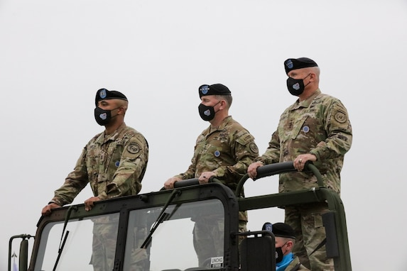 """Army Capt. Matthew Kemelek, General Robert B. """"Abe"""" Abrams, and General Paul J. LaCamera inspect the troops during the United Nations Command, Combined Forces Command, and U.S. Forces Korea change of command ceremony on July 2, 2021 at Barker Field. (U.S. Army photo by Staff Sgt. Kris Bonet)"""