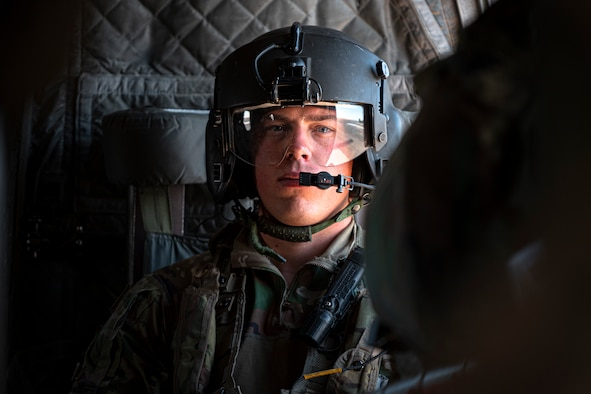 A photo of a Soldier in a seat of a CH-47 Chinook