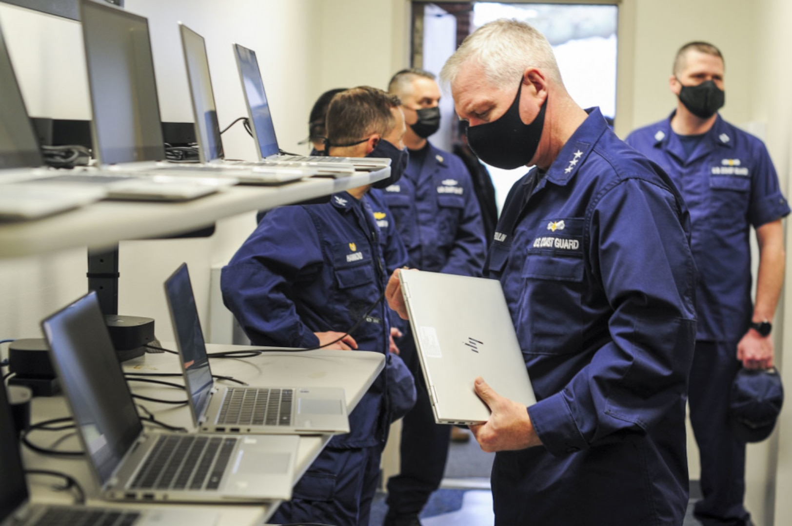 Vice Adm. Steven Poulin, Coast Guard Atlantic Area Commander, interacts with Coast Guard Training Center Yorktown's current technological training equipment, March 23, 2021. Poulin studied the equipment inside one of the training center's server rooms during a recent tour. U.S. Coast Guard photo by Seaman Santiago Gomez.