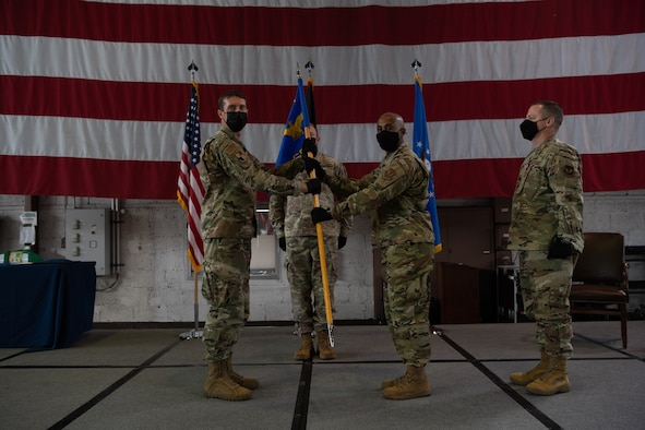 U.S. Air Force Col. David Epperson, 52nd Fighter Wing commander (left), passes the 52nd Comptroller Squadron guidon to Maj. Lee Washington, incoming 52nd CPTS commander, at the 52nd CPTS change of command ceremony at Spangdahlem Air Base, June 30, 2021. The commander of the comptroller squadron also is responsible for overseeing the Wing Staff Agencies, which encompasses many flights such as Command Post, Public Affairs and the base legal office. (U.S. Air Force photo by Senior Airman Ali Stewart)