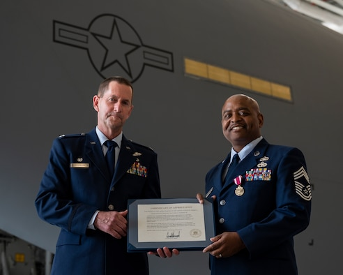 Col. John F. Robinson, 911th Airlift Wing commander, presents a certificate of appreciation for service in the armed forces to Chief Master Sgt. William T. Andrews, 911th Logistics Readiness Squadron superintendent, during a retirement ceremony at the Pittsburgh International Airport Air Reserve Station, Pennsylvania, June 5, 2021.