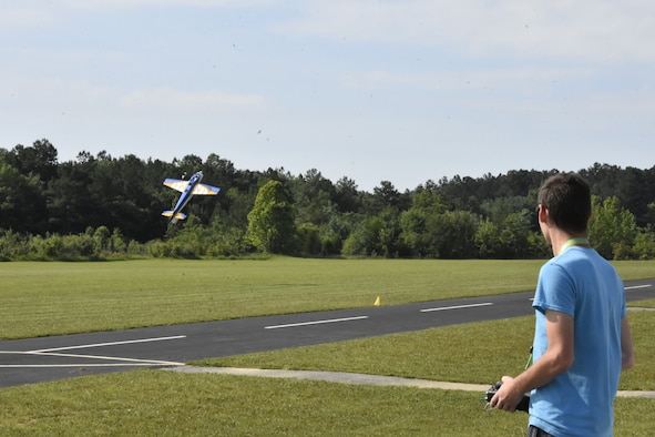 Nicholas Amelang puts on an RC aerobatics demonstration during a June 26, 2021, event hosted by the Coffee Airfoilers Model RC Club to coincide with the Arnold Engineering Development Complex 70th anniversary celebration at Arnold Air Force Base, Tenn. (U.S. Air Force photo by Bradley Hicks)