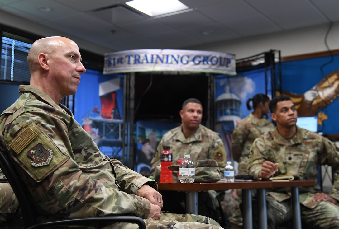 U.S. Air Force Col. William Hunter, 81st Training Wing commander, attends an 81st Training Support Squadron briefing inside the Trainer Development Center during an 81st Training Group immersion tour at Keesler Air Force Base, Mississippi, June 22, 2021. The purpose of the tour was to become more familiar with Keesler's mission. (U.S. Air Force photo by Kemberly Groue)