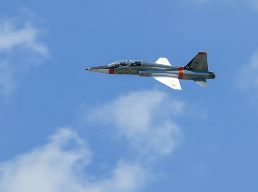 """A T-38 Talon is flown over Arnold Air Force Base by Airmen of the 586th Flight Test Squadron, 704th Test Group, Arnold Engineering Development Complex, during a flag retreat ceremony after the AEDC """"Hap Arnold Day"""" 70th Anniversary June 26, 2021. The aircraft was flown by Lt. Col. Alex """"Cuda"""" Wolfard and Maj. Ali """"Axle"""" Hamidani. (U.S. Air Force photo by Jill Pickett)"""