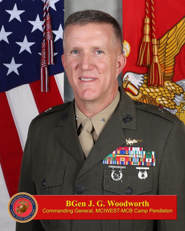 Brigadier General Jason Woodworth currently serves as the Director of Manpower Plans and Policy, Manpower and Reserve Affairs.  His prior assignment was as the Secretary of the General Staff for Headquarters Marine Corps in the Pentagon.  He has served in various billets in the FMF as a FA-18 pilot, primarily at Miramar, where he commanded VMFA-323 from 2011-2013, and was the Air Station CO from 2015-18.  His joint tour was as an Arms Control Inspection team chief with Defense Threat Reduction Agency in Germany, and he also served as a MAWTS instructor in Yuma, Arizona.  Brigadier General Woodworth participated in multiple contingency operations during deployments to the Middle East.    Brigadier General Woodworth is a native of Suffield, Connecticut and attended Colgate, University of Oklahoma, and King's College, London.  He and his wife, Renee, have three children.