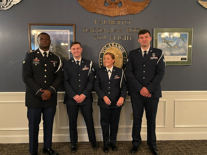 Classmates from ALS Class 21-4 pose to take a photo before graduation on Shaw Air Force Base, S.C., May 6, 2021. Airman Leadership School prepares service members and civilians  to become team leaders and frontline supervisors that help better our military.