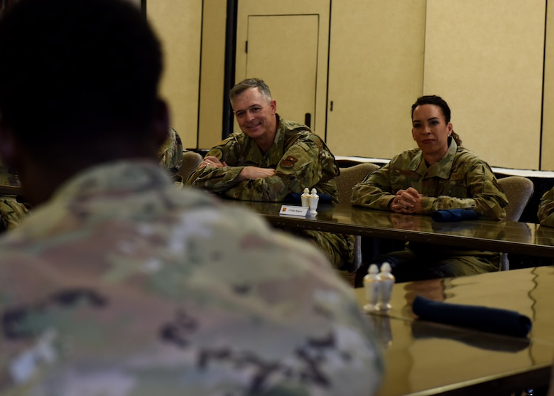 U.S. Air Force Maj. Gen. Craig Wills, left, 19th Air Force commander, and U.S. Air Force Chief Master Sgt. Kristina Rogers, 19th AF command chief, speak with Airmen assigned to the 56th Fighter Wing during a luncheon, June 28, 2021, at Luke Air Force Base, Arizona. During the luncheon, Airmen discussed with senior leadership various topics such as GI Bill benefits, mental health, and diversity and inclusion within the Air Force. Leadership from the 19th AF visited Luke AFB to engage with the 56th Fighter Wing and gain a better understanding of the successes and challenges faced by the wing. (U.S. Air Force photo by Tech. Sgt. Franklin R. Ramos)
