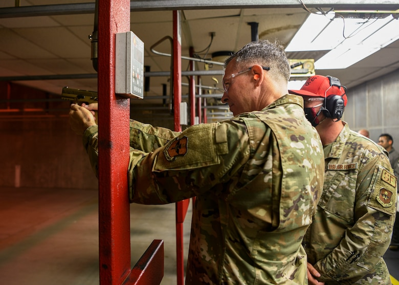 U.S. Air Force Maj. Gen. Craig Wills, 19th Air Force commander, fires an M9 Beretta while visiting the 56th Security Forces Squadron Combat Arms Training and Maintenance facility, June 29, 2021, at Luke Air Force Base, Arizona. Leadership from the 19th AF visited Luke AFB to engage with the 56th Fighter Wing and gain a better understanding of the successes and challenges faced by the wing. The 56th FW's mission is to train the world's greatest fighter pilots and combat-ready Airmen. (U.S. Air Force photo by Airman 1st Class David Busby)
