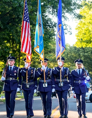 Members of the Dover Air Force Base Honor Guard march the colors during the annual Fourth of July Celebration parade in Dover, Delaware, July 4, 2021. The celebration also included a reading of the Declaration of Independence, tours of the Old State House, musical entertainment and a fireworks display. (U.S. Air Force photo by Senior Airman Stephani Barge)