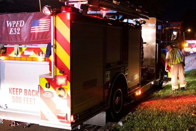 A firefighter responds to a medical call for help, June 23, 2021 at Wright-Patterson Air Force Base, Ohio.  The base has three stations strategically located to ensure a response time of 5 minutes or less when the call comes in. (U.S. Air Force photo by Wesley Farnsworth)