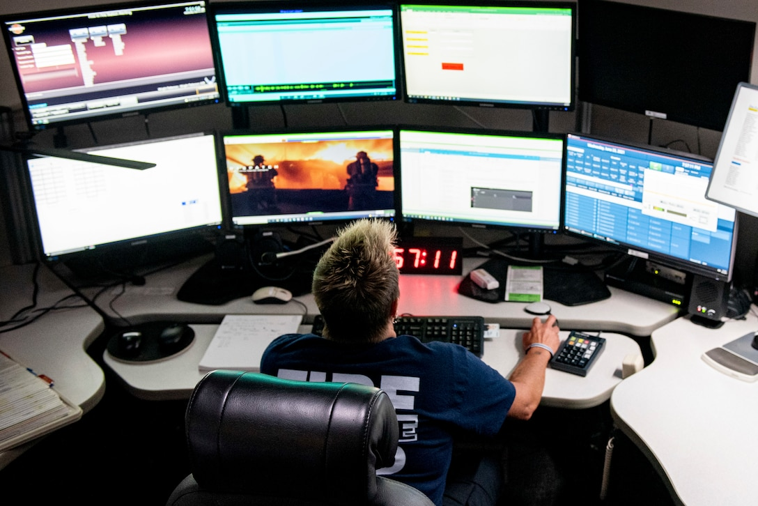 Marian Nevin, 788th Civil Engineer Fire Department dispatcher, works at her station inside the control and dispatch room of Station 1, June 23, 2021, at Wright-Patterson Air Force Base, Ohio. The fire department is on call 24/7 all year and capable of responding anywhere on base within 5 minutes when a call for help comes in. (U.S. Air Force photo by Wesley Farnsworth)