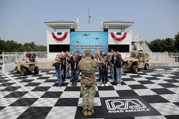 Brig. Gen. Ernest Litynski, Commanding General, 85th U.S. Army Reserve Support Command, swears in future Soldiers, in the Winner's Circle, during the Fourth of July NASCAR Cup Series race at Road America, Elkhart Lake, Wisconsin, July 4, 2021.