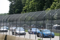 The pace car leads drivers in the initial lap across a four-mile track during the Fourth of July NASCAR Cup Series race at Road America, Elkhart Lake, Wisconsin, July 4, 2021.