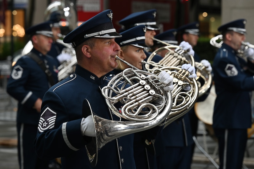 U.S. Air Force Master Sgt. Mike Hampf, a French horn player assigned to The United States Air Force Band's Ceremonial Brass, plays during a live broadcast on the TODAY Show in New York City July 2, 2021. The official ceremonial ensemble comprises 41 active-duty Airmen who provide musical support for funerals at Arlington National Cemetery, arrivals for foreign heads of state at the White House and Pentagon, patriotic programs, changes of command, retirements, and awards ceremonies. (U.S. Air Force photo by Staff Sgt. Kayla White)