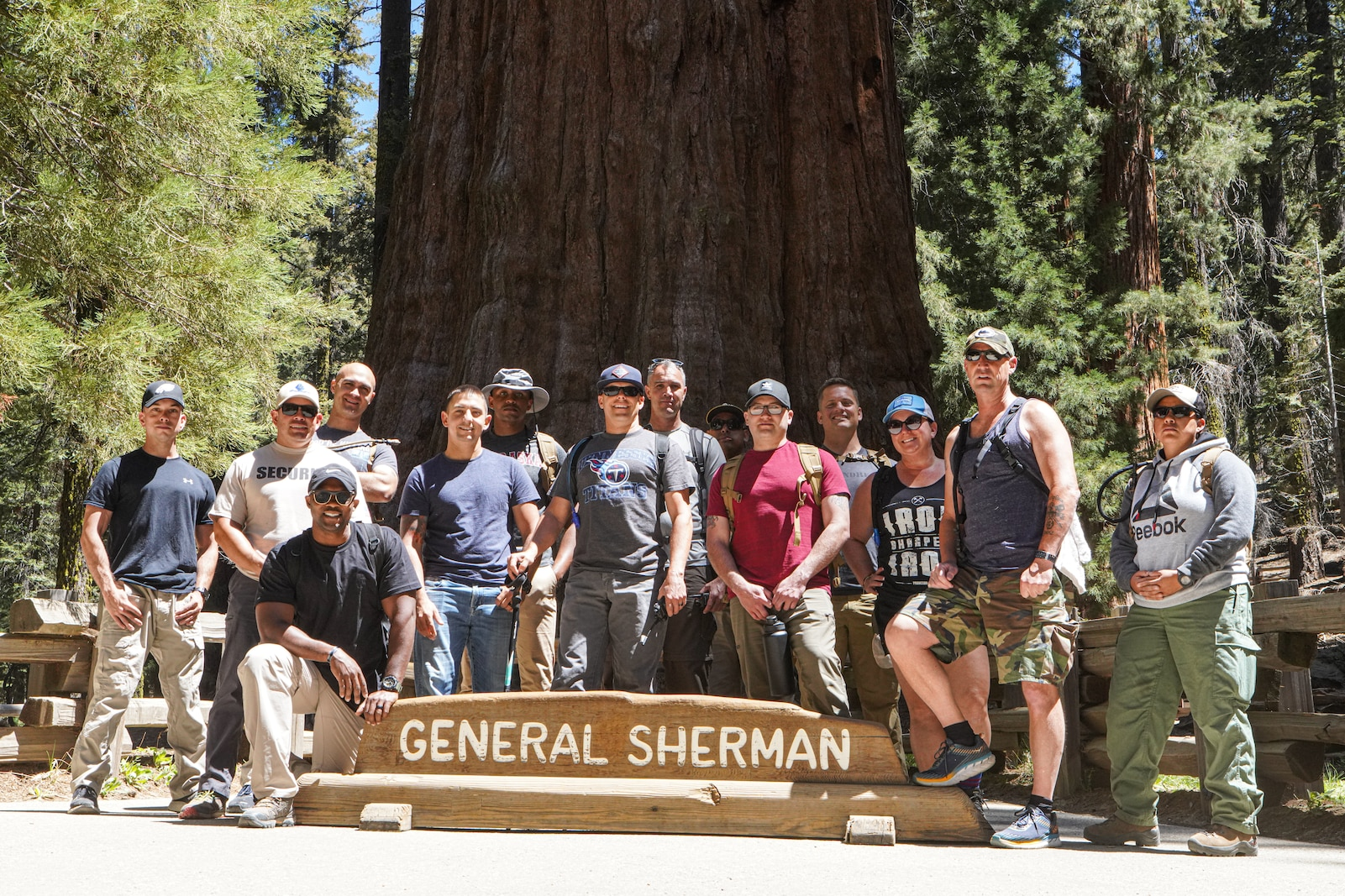 U.S. Marines with I Marine Expeditionary Force Information Group, pose for a group photo in front of the General Sherman Tree at Sequoia National Forest during a leadership retreat by Kaweah Lake, California, May 26, 2021. The three-day retreat in the Sequoia National Forest focused on connectedness and personal growth to increase individual and unit resilience. It provided participants with the tools and resources to shape their units' training programs, build character and equip their peers and subordinates with greater life resiliency skills. The interconnectedness of the roots of the Sequoia trees is a metaphor for the network of Marines and sailors that rely on each other through every rank and life situation. The trees are also a metaphor for unit Esprit-de-Corps that expands across a much larger national network. This inaugural retreat set the foundation for future, similar events that will include conditioning events, lectures, guided discussions and guest speakers. (U.S. Marine Corps Photo by Lance Cpl. Aidan Hekker)