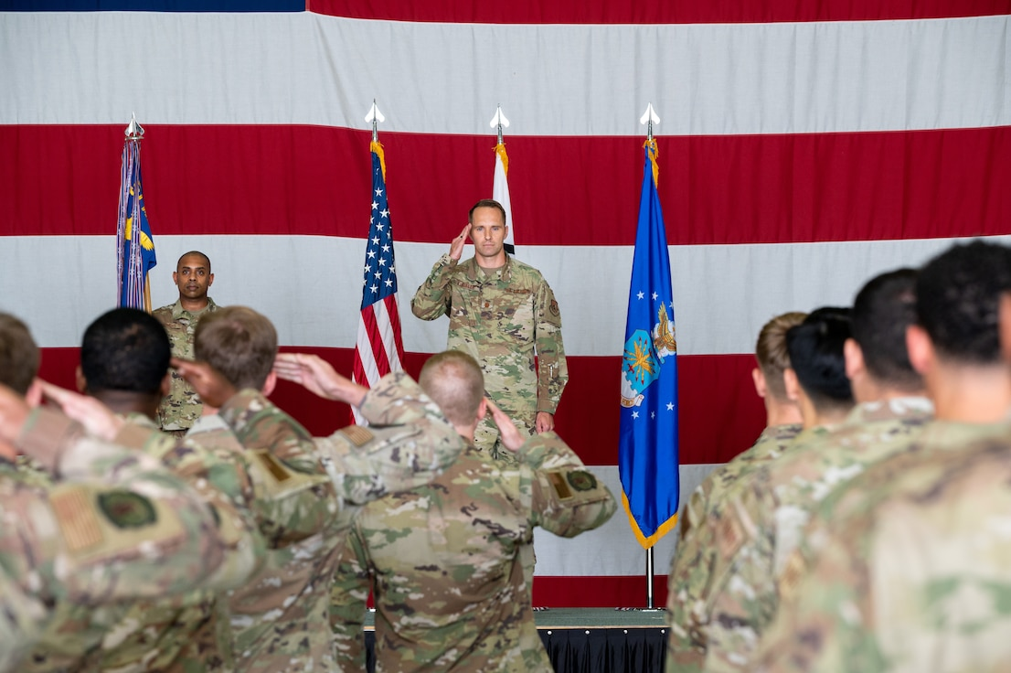 Maj. Scott Kubalek, 51st Munitions Squadron inbound commander, returns a salute to his squadron during the change of command ceremony at Osan Air Base, Republic of Korea, July 6, 2021. The ceremonial passing of the guidon to Kubalek marks the official beginning of his command of the 51st MUNS. (U.S. Air Force photo by Tech. Sgt. Nicholas Alder)